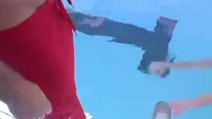 Nasty woman is masturbating next to her swimming pool not knowing that she is being recorded