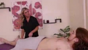 Blonde masseuse sucking cock on her client